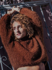 rust ochre coloured knitwear