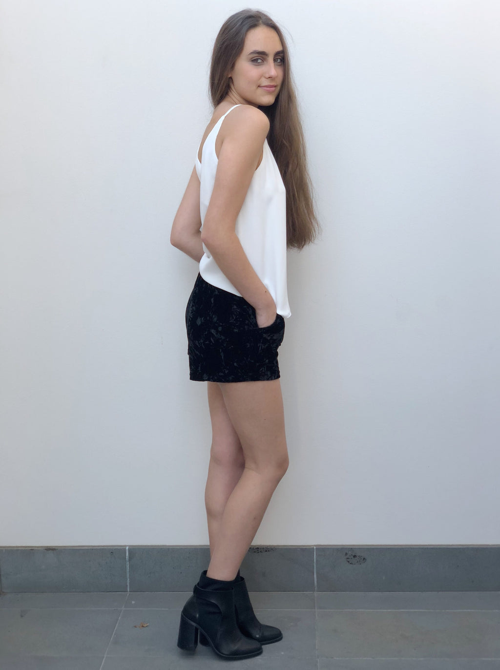 Black velvet shorts are flattering and feature pockets and an elastic waist.