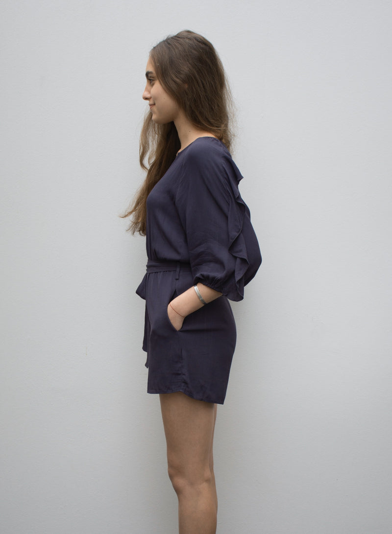 Navy Playsuit featuring ruffled sleeves and pockets