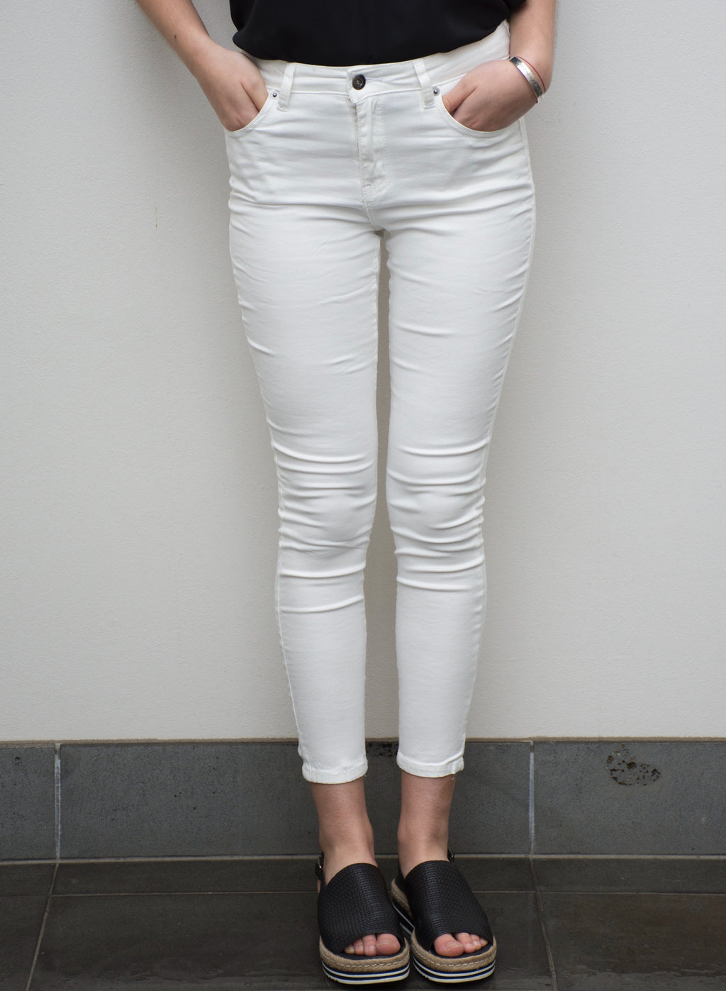 White denim slim fit jeans with four handy pockets.