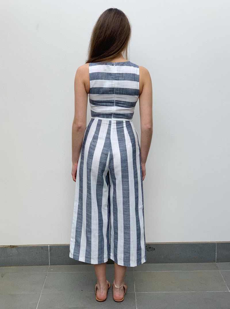 Blue and white striped sleeveless jumpsuit with long wide leg style pant and pockets