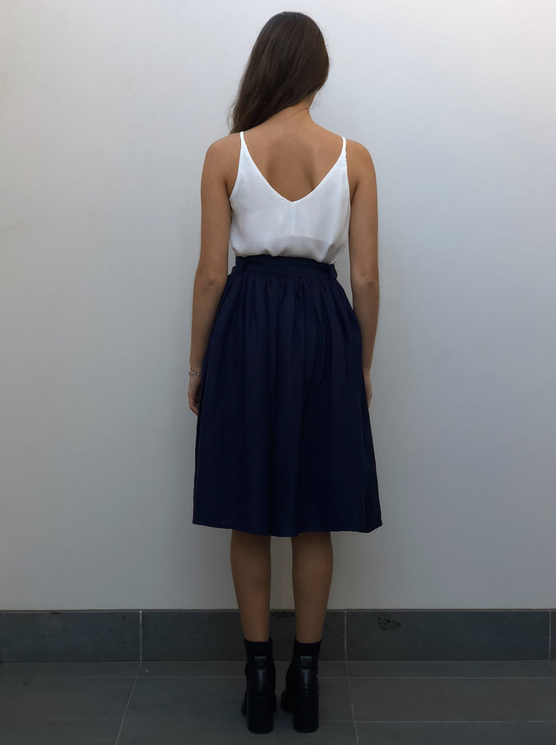 Navy midi skirt featuring side seam pockets, a waist tie and a slightly stretch waist for comfort.