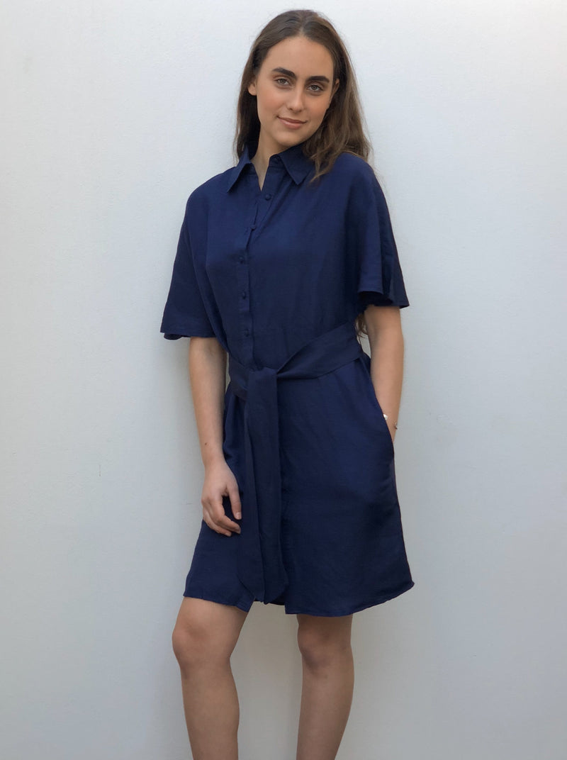 Shirt dress with flare sleeve, button down front, side seam pockets and a tie up waist belt.