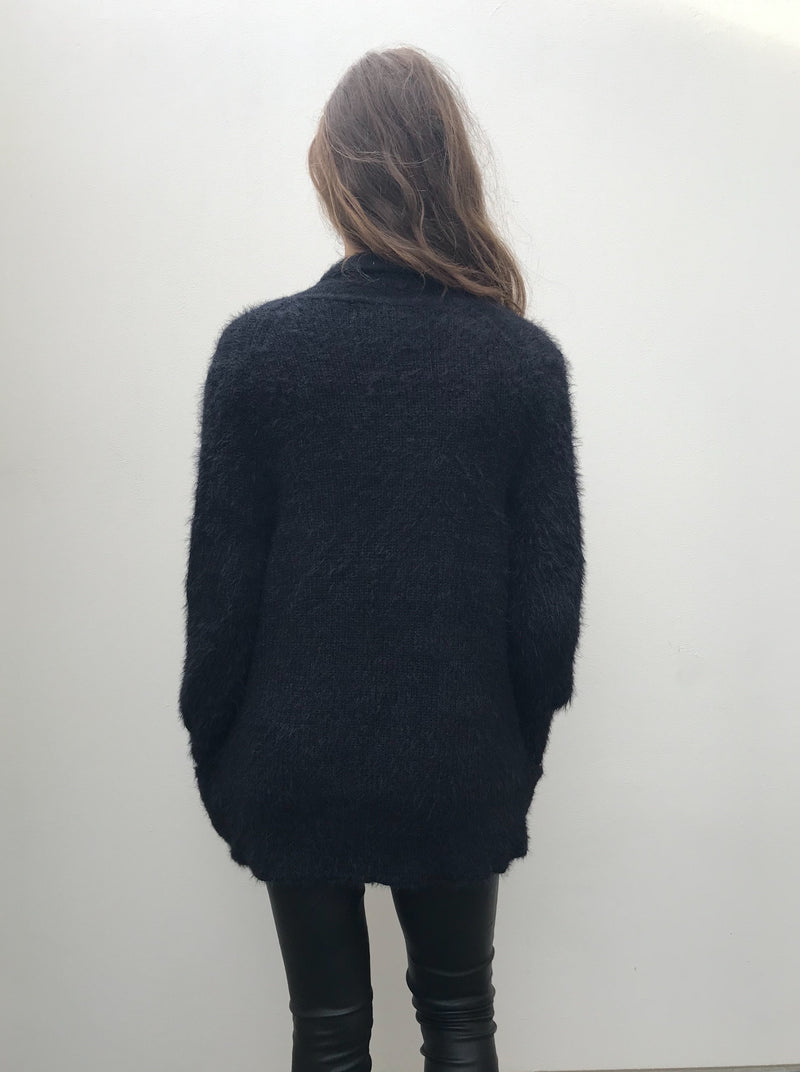 Black, fluffy comfortable cardigan with pockets