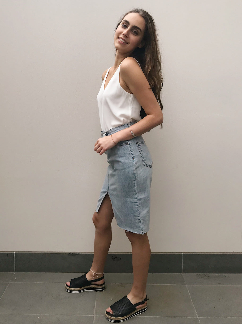 Blue Denim Skirt featuring a front slit and four pockets
