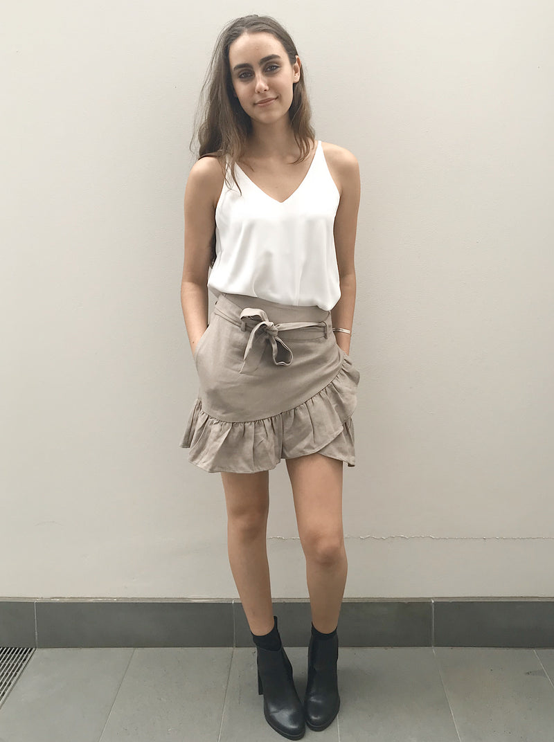 Dove grey wrap skirt featuring frill hemline, waist tie and in-seam pockets.