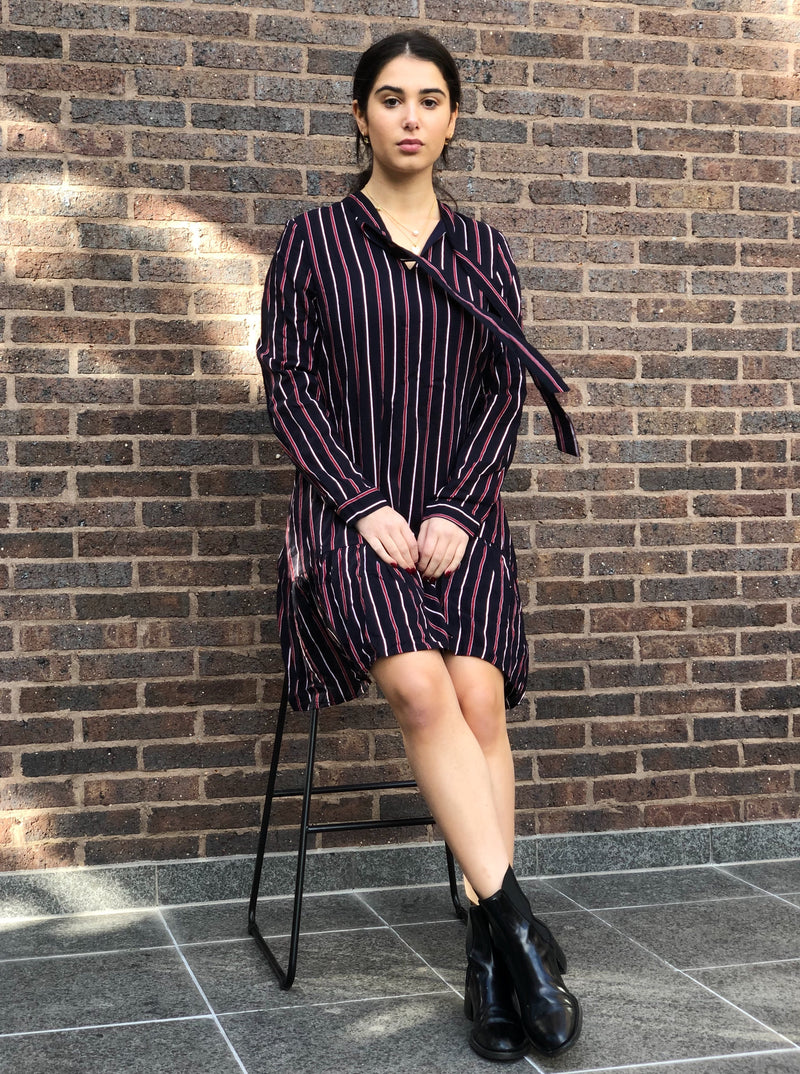 Navy and red striped dress featuring a neck tie, drop hem and side pockets.