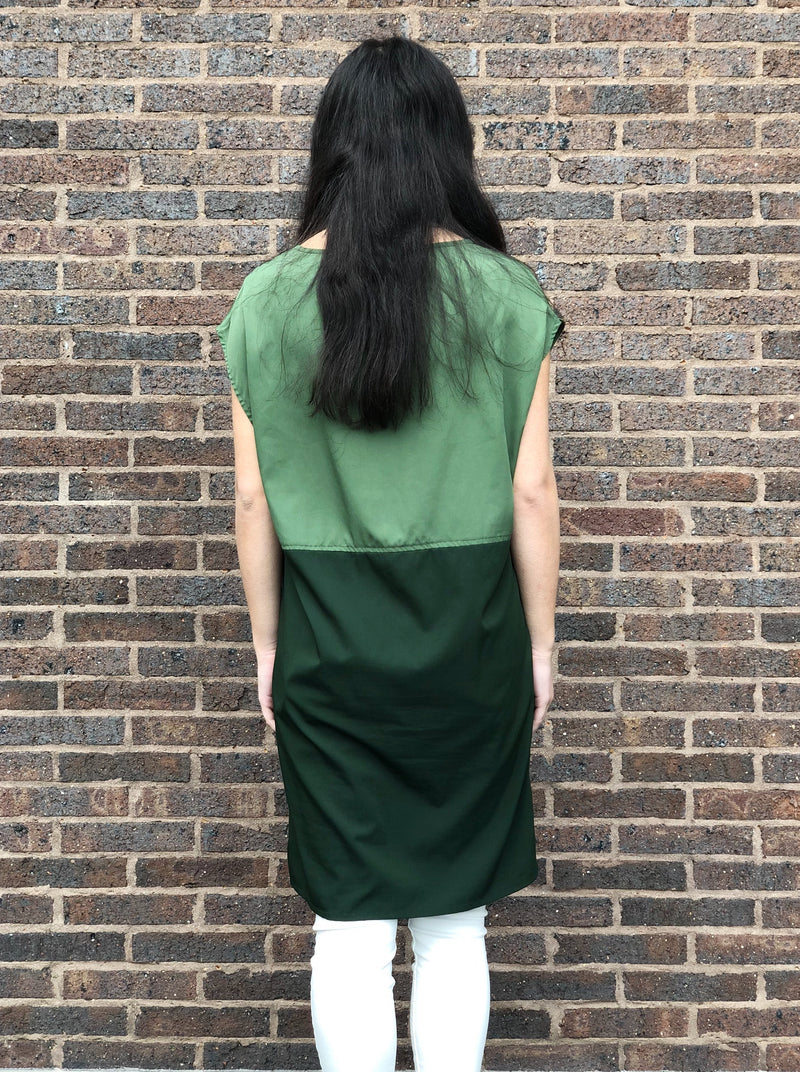 Olive & forest green shift dress featuring a boat neckline and roomy side seam patch pockets.