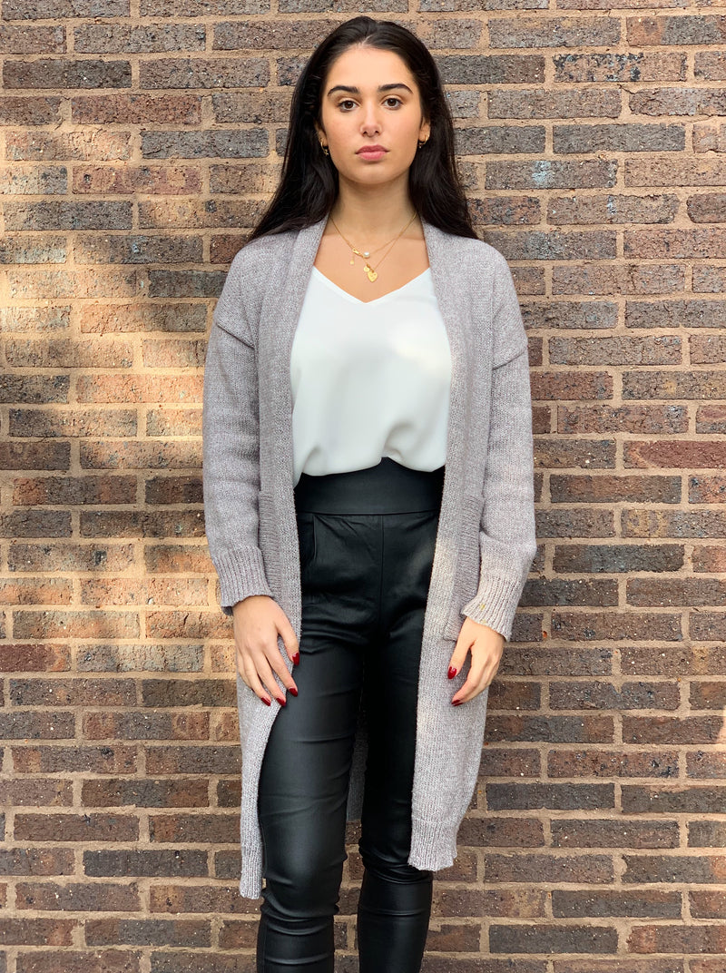 Grey longline cardigan with side pockets.