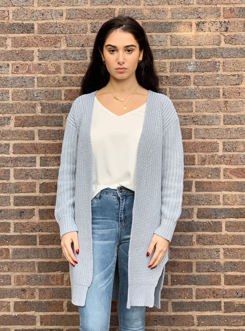 Grey cardigan featuring pockets, side splits and is a relaxed fit.