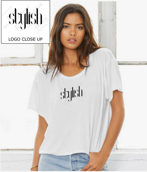 "Ladies Flowy Boxy T-Shirt in White with simple logo saying ""Stylish"" with other background words"