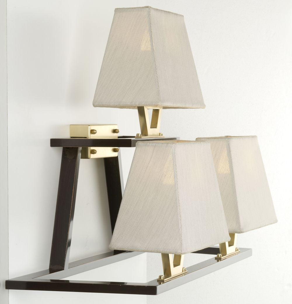 Understated modern Italian brass wall light with gold shades