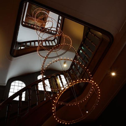 Studded LED ring  pendant for single or modular use in a modern stairwell