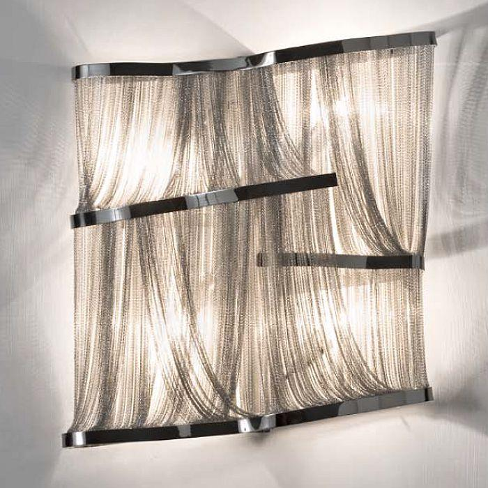 The 'Atlantis' metal chain wall light from Terzani in gold, bronze, nickel or black nickel