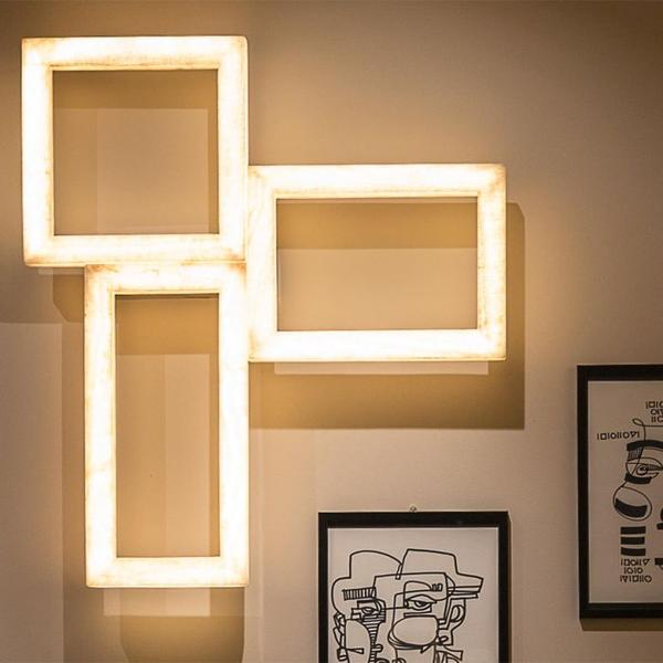 Quirky and unique triple picture frame style light in a neutral marble colour