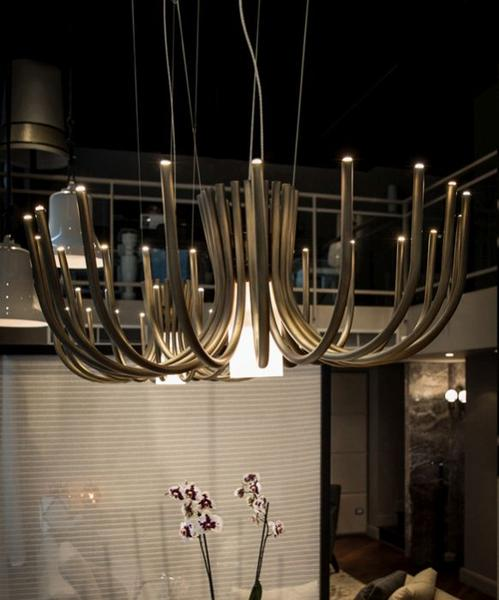 Understated small  modern chandelier in bronze or black metal