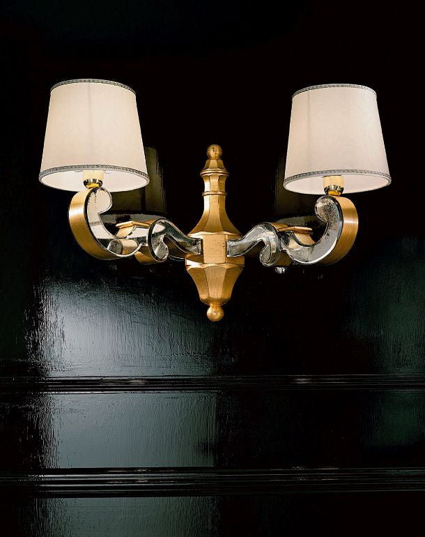 High end golden Venetian wall light with hand-bevelled mirror inserts