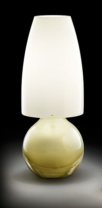 The Argea Murano glass table lamp from Venini with gold or silver finish