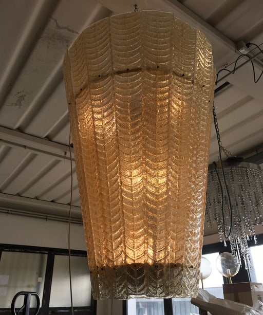 Tall bespoke amber  lanterns with amber flecks