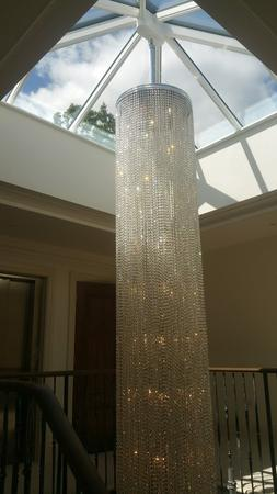 Specially-commissioned 8 metre-tall stairwell chandelier with sparkling crystals