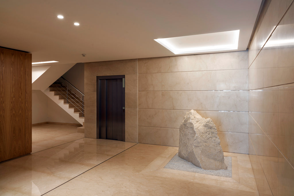 crema marfil floor and wall cladding entrance hall building Malta