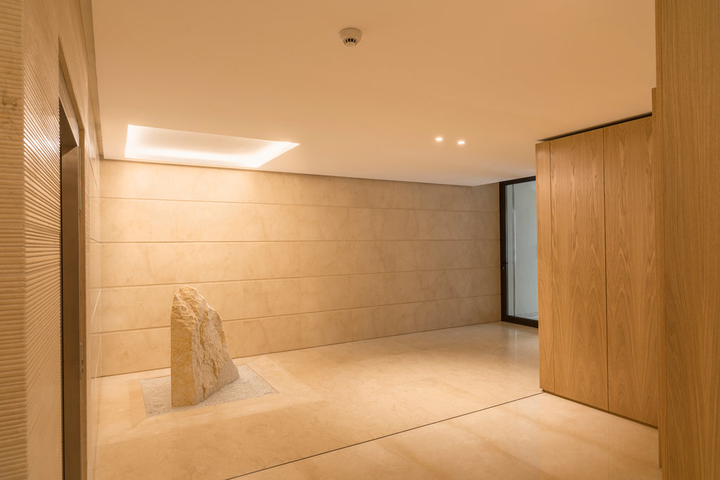 crema marfil floor and wall cladding entrance hall building Malta rock decoration