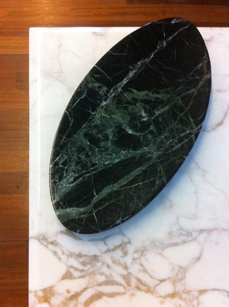 dark green and black marble object