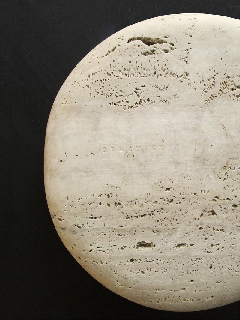 travertine plate black background