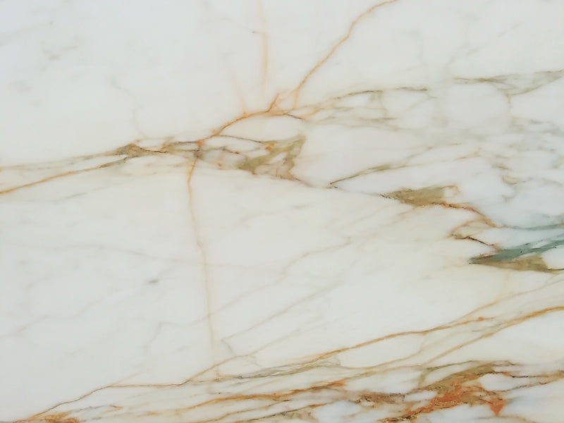 Calacatta Oro marble slab background white and gold malta