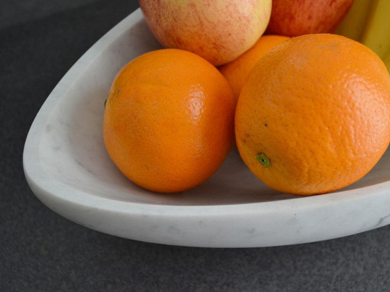 fruit bowl oranges close up bianco carrara