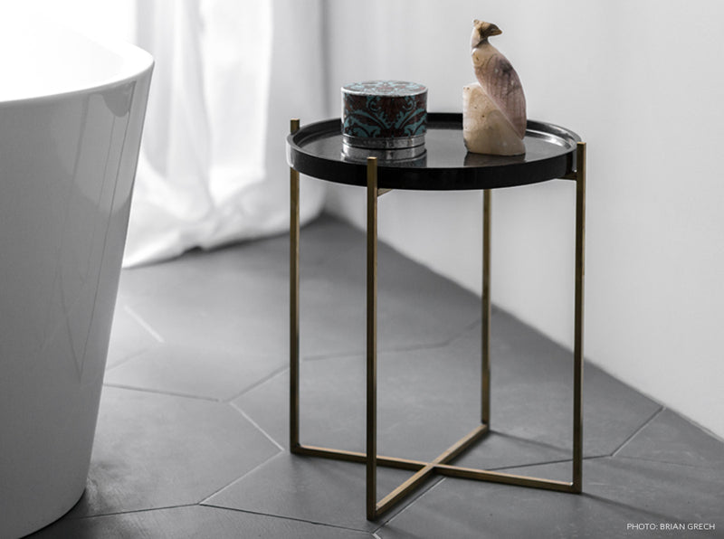 black marble coffee table with object on the top