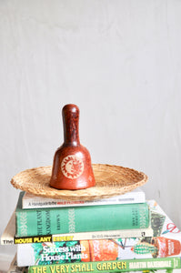 Vintage pottery bell with zodiac pattern