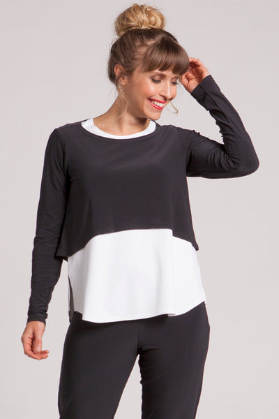 Cropped length top featuring a round neck, long sleeves and relaxed body. Ideal for layering.