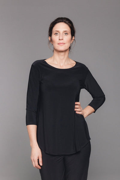 Longer tee with scoop neckline, side vents and a slightly rounded hem. Features 3/4 sleeves and a relaxed A-line shape.
