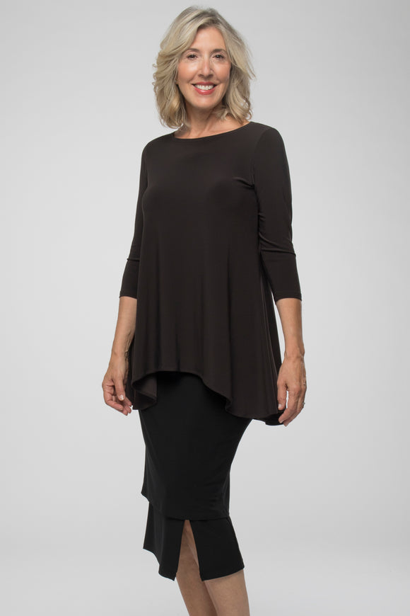Longer top with a high low hemline and an easy, flared A-line body. Features a rounded boat neck and 3/4 sleeves.