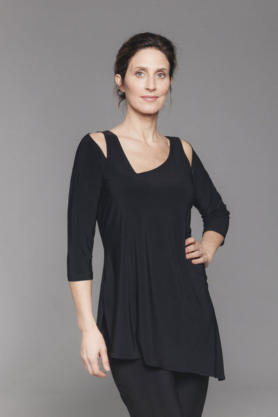 Tunic with an asymmetrical V-neck and small shoulder cutouts.  Features 3/4 sleeves and an angled hem with side slits.