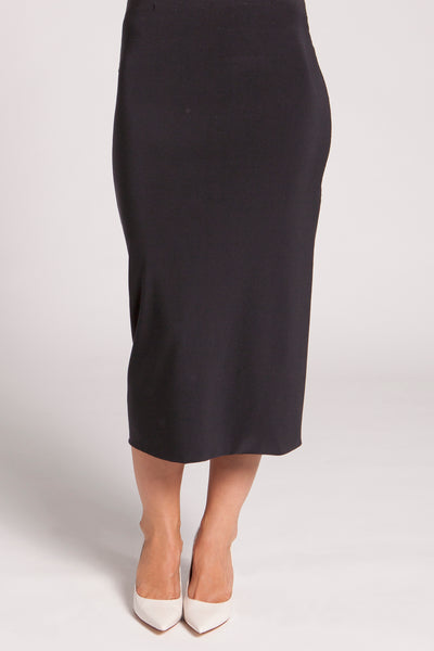 A double layered straight skirt with a hidden stretch elastic waist and fitted silhouette. Hits below the knee.