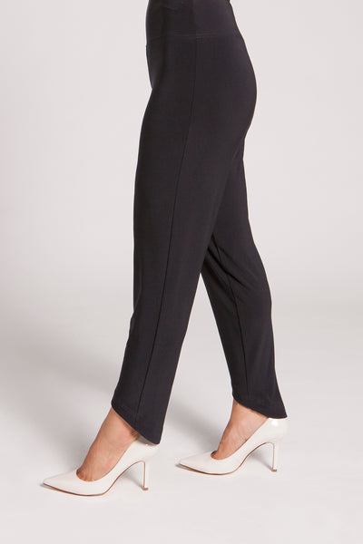 Sleek pant with a short, curved hem. The drop yoke waistband gives a slimming effect while the pant drops gracefully to the ankle and covers the heel.