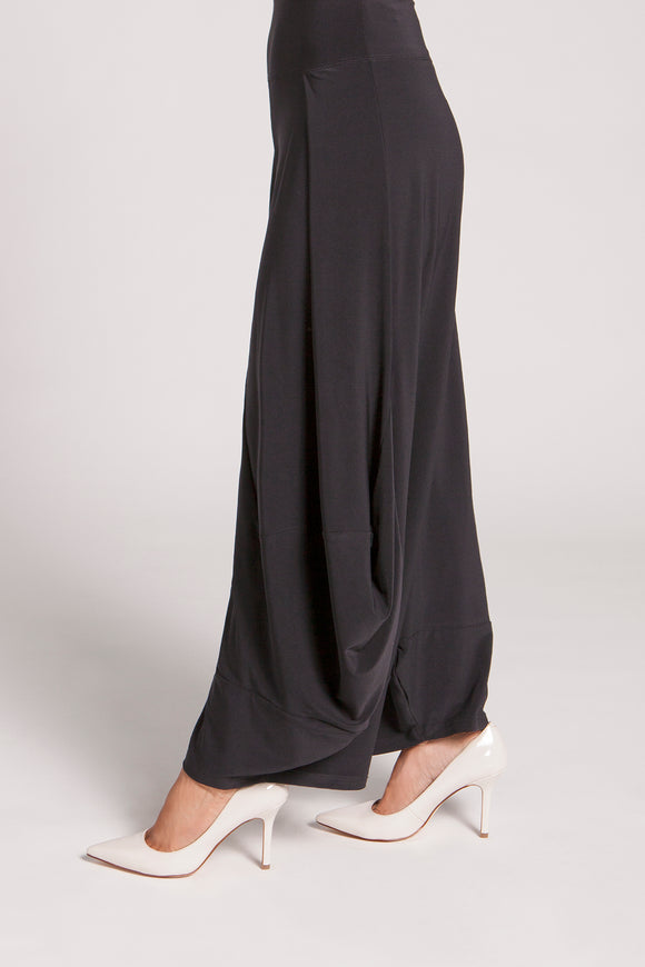 Harem style pants with ballooned bottoms and pleat details at waist. Buttons and loops at both inner and outer leg seams allow for a versatile and unique look. Pull-on yoke style elastic waist.