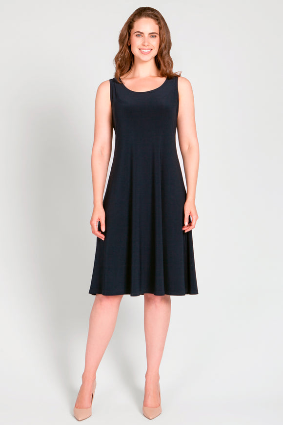 Sleeveless tank dress with a rounded neckline, wide tank straps and hits just below the knee.