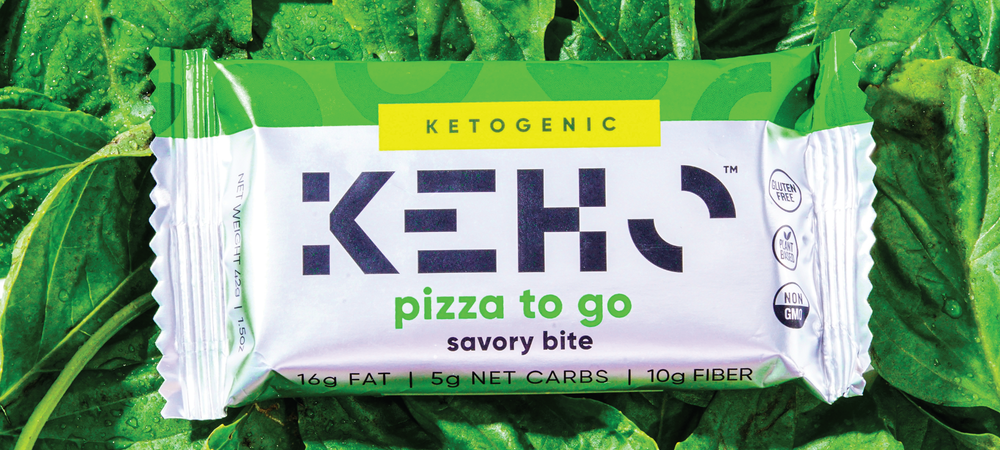 Pizza to go real whole food savory snack bite that is vegan keto on a bed of basil