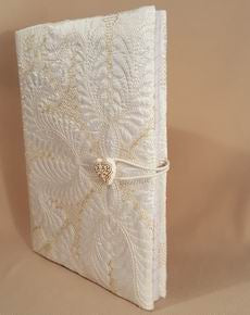 HOW TO MAKE: a Quilted Book Cover at astitchahalf.net