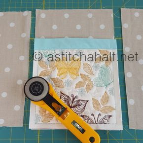 HOW TO MAKE: an Adjustable Fabric Book Cover at astitchahalf.net