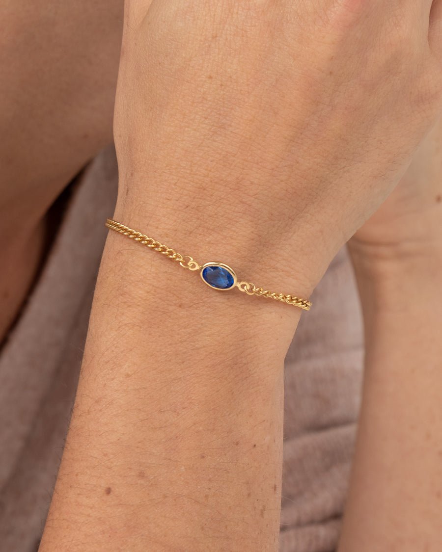 Gold-plated bracelet with blue Swarovski crystal