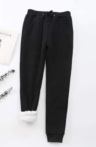 Cheri sherpa-lined sweatpants in black | Plum Hanger