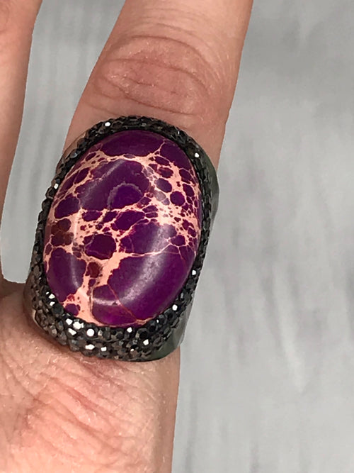 Close up of Plum Lightening Ring | Plum Hanger