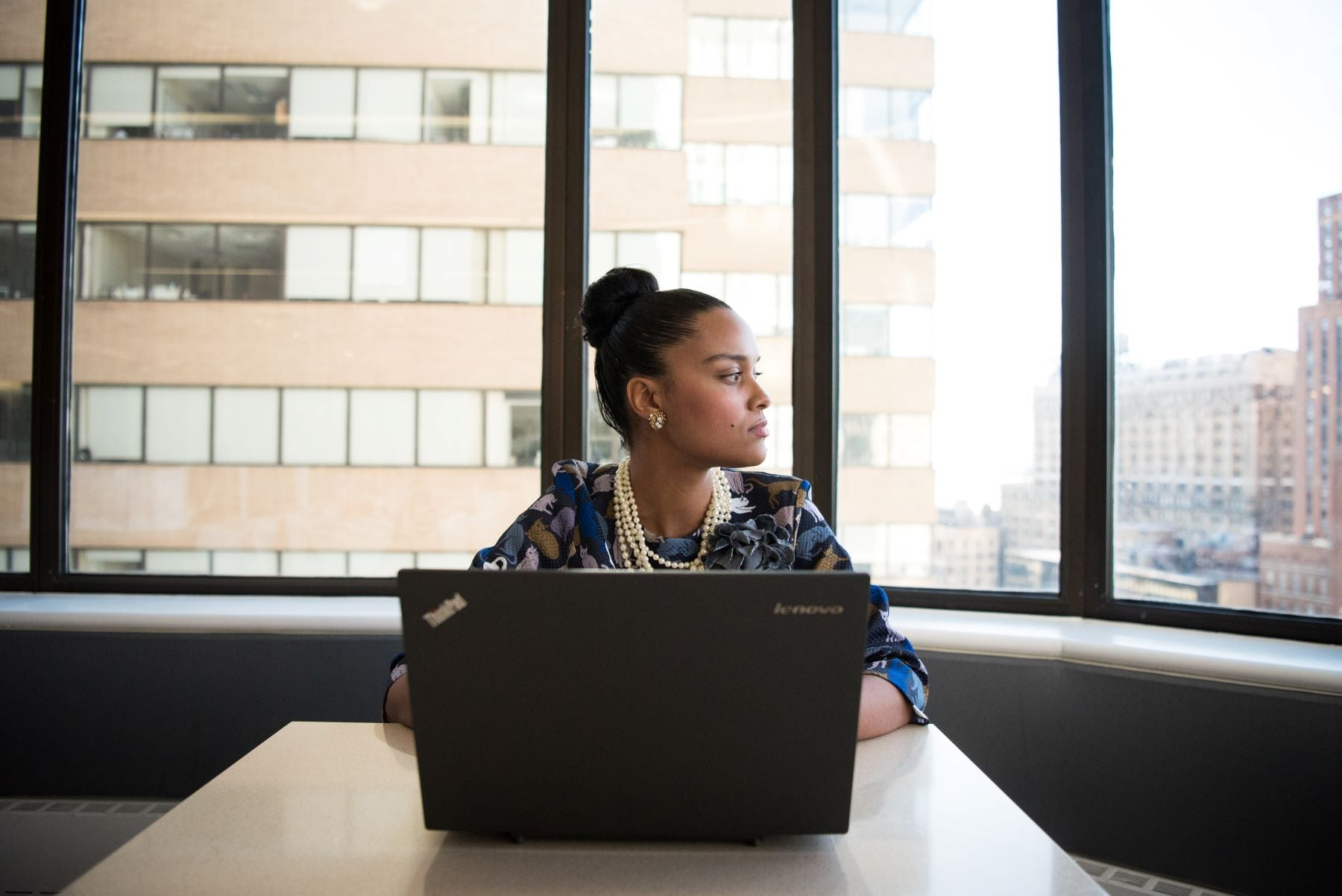 do i need a registered agent - businesswoman in conference room