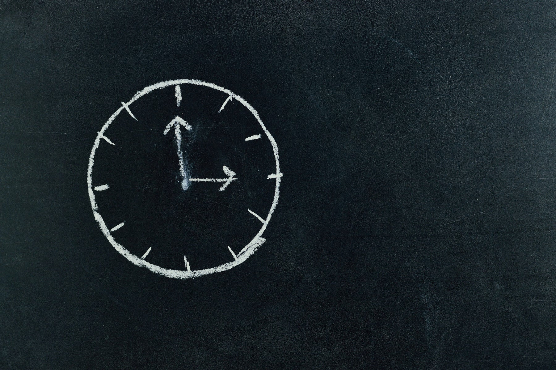 image of clock on chalkboard for article about how long certificate of good standing documents are good for