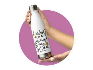 Ask Me About My Garden water bottle from Ferry-Morse against a purple circular background.