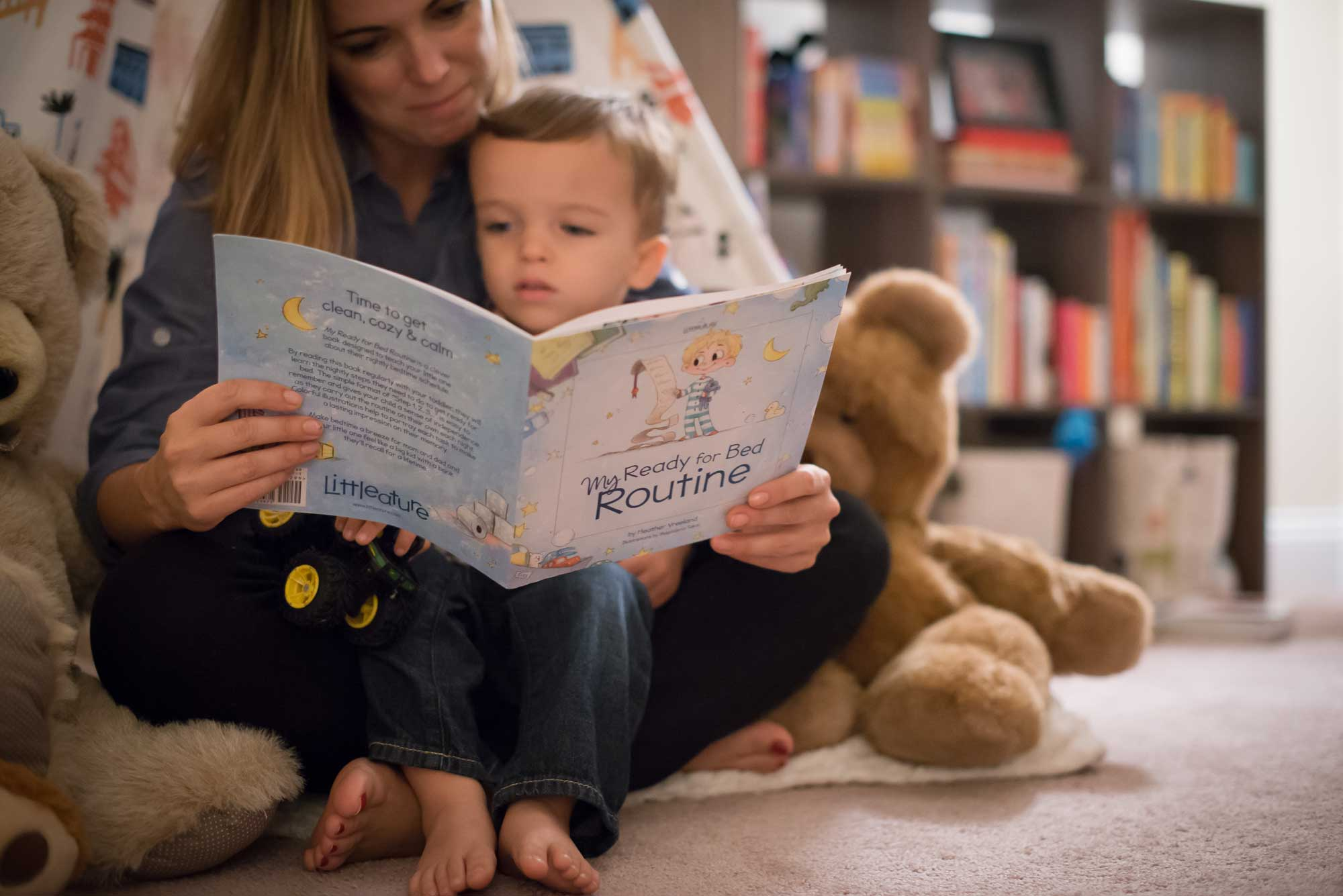 mom reading bedtime routine book to toddler